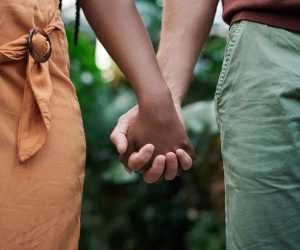 man-and-woman-holding-hands-3228726